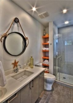 adorable small bathroom ideas with shelves on the corner and circle mirror