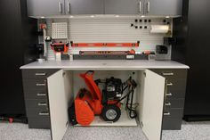 Love this great, super easy to make snowblower storage! Easy to stow and easy to pull out (I'd add a rope handle tow strap so I wouldn't have to bend over to pull it out though). Overwhelmed by a messy garage? Conquer clutter with these genius garage storage and organizing hacks from HGTV.com.