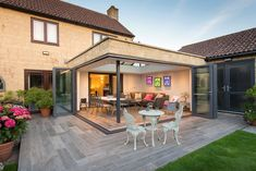 Corner Bi-fold Doors Bring This Orangery To Life House Extension Plans, Orangery Extension Kitchen, Orangery, Patio Design, Corner Door, Backyard Seating Area, Bifold Patio Doors