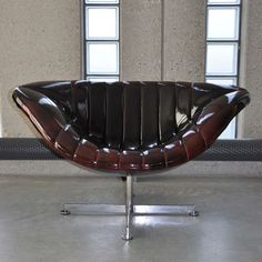 Anonymous; Chromed Metal and Vinyl Armchair by Rohe, 1974.