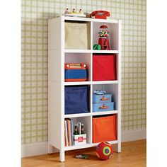 For storage, I'd recommend adding our 8-cube bookcase in White. It gives plenty of room to display collections and other things C will collect. And, also is functional for book and toy storage.