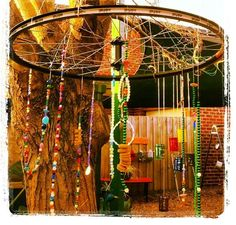 Bike wheel with different objects to make a hanging mobile! A great sustainability idea