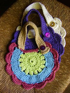 Baby Bibs for Violet From ravelry.com  follow the links at Ravelry for the free pattern  How adorable!