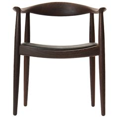 we have a set of these chairs! beautiful design & so comfortable - Round Chair in Wenge by Hans J. Wegner  Denmark  1950