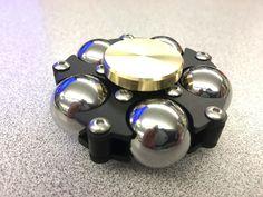 Premium Sphidget showing add on brass buttons