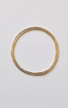 """ODETTE FORTUNA BANGLE  Classic thin brass bangle with double sided texture. Slips on.  2.75"""" in diameter.    Material: Brass"""