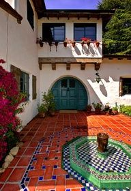 Spanish colonial style courtyard with fountain and gorgeous tile!