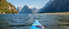 Explore Milford Sound by sea kayak you'll get a real sense of this dramatic, moody place. Sea Kayak, Milford Sound, Adventure Is Out There, Paddle, Kayaking, New Zealand, Explore, Mountains, Places
