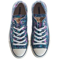 """Chucks are the allrounder all year long! These low sneakers """"All Star OX"""" in trendy dark blue """"Dark Denim"""" colour impress by their feminine flower print. Wear …"""