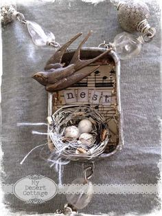 Love this nest idea only do One of mine in rusty tin, with music in background, and nest word. I like this cute necklace from Faded Charm, but my nests would not hold up being worn all the time. =)