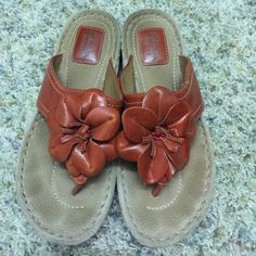Orange Leather Clarks Sandals Clarks sandals. Size 6.5. Cute style with pretty orange flower in front. Looks cute with skirts, dresses, shorts, etc. Clarks Shoes Sandals