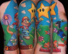 mario-bross-tattoo-game-design-on-arm1.jpg (700×560)