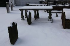Some of our tombstones covered in snow