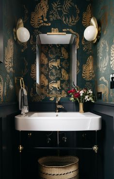 Dramatic Bathroom Design by Leah Phillips Interiors:  Dark and Moody Powder Room Re-do, Tiger Wall Paper, Modern Brass Sconces, Brass Hardware,  modern wainscot, cement tile,  white ceramic sink console, Painted wainscoting with Soot by Benjamin Moore, Chicago bathroom design, Chicago interior design, Chicago Interior Designer, bathroom design, moody bathroom, powder room design, dramatic bathroom Powder Room Wallpaper, Bathroom Wallpaper, Moody Wallpaper, Tiger Wallpaper, Dark Bathrooms, Beautiful Bathrooms, Eclectic Bathroom, Bathroom Interior Design, Modern Bathroom