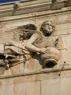 One of the wind sculptures on the Tower of the Winds, Athens, Greece