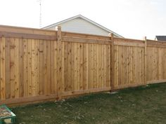Backyard Wood Fence Ideas this solid privacy fence is a stylish backdrop to a garden This Is Nice I Dont Love The Post Tops However I Have A Backyard Pinterest Stains Fence Design And Backyards