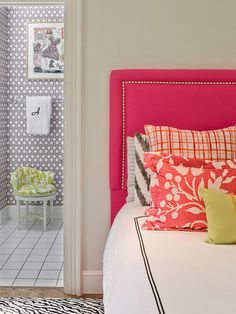 Upholstered headboard DIY. Really cute! And check out the wallpaper in the bathroom. Love!