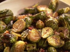 Balsamic-Roasted Brussels Sprouts Recipe 1 1/2 pounds Brussels sprouts, trimmed and cut in half through the core 4 ounces pancetta, 1/4-inch-diced 1/4 cup good olive oil Kosher salt and freshly ground black pepper 1 tablespoon syrupy balsamic vinegar  Read more at: http://www.foodnetwork.com/recipes/ina-garten/balsamic-roasted-brussels-sprouts-recipe.html?oc=linkback