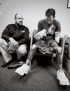 Bryan Anderson, Iraq War Veteran. One robotic arm, and two robotic legs.