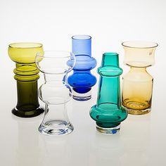 "TAMARA ALADIN - Glass vases for Riihimäen Lasi Oy, 1966-76, Finland. - ""Kielo"", 1563, green glass, height 20 cm, designed 1972, produced 1974-1976. ""Kielo"", 1560, clear glass, height 20 cm, designed 1972, produced 1974-1976. ""Solmuke"", 1474, blue glass, height 20 cm, designed in 1966, produced 1967-1974. Vase in green glass, 1466, height 20,5 cm, designed 1965, produced 1967. ""Ruusu"", 1477, brownish glass, height 20 cm, designed 1966, produced 1967-76. Glass Design, Design Art, Clear Glass, Glass Art, Lassi, Mid Century Decor, Bukowski, Aladdin, Finland"