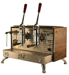 I love the natural wood veneer on this espresso machine.  This really looks like a work of art.  The stainless steel really shines against that bronze colored backing.  My wife and I have been looking for a lever espresso machine.  I'd love to get her something like this for her birthday.