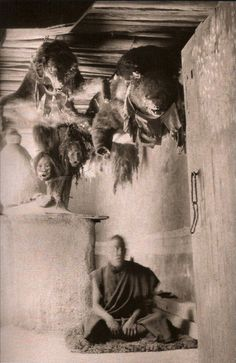 A meditation chamber with dead animals and shrunken human heads. Tibet, 1920.