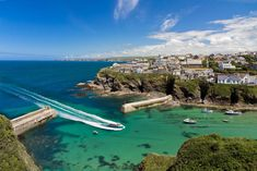 Remember that time England looked like Italy. Cove and harbour of Port Isaac with arriving ship, Cornwall, England by Frank Fischbach, via Cornwall England, West Cornwall, England Uk, Holiday Destinations, Vacation Destinations, Vacation Ideas, Things To Do In Cornwall, Cornwall Beaches, Port Isaac