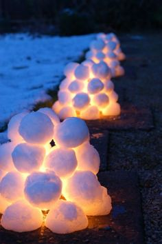 SNOW LANTERNS: My own kids made these this winter and they worked brilliantly. Thanks to LittleGreenFingers blog. Great if you don't have enough snow for a snowman but the kids want to build something and they look amazing in the dark.