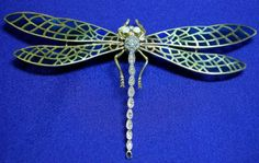 18kt Gold, Diamond and Gem-set Plique-à-jour Enamel Dragonfly Brooch, with polychrome enamel wings, body set with circular-cut diamond and ruby melee, cabochon opal eyes.