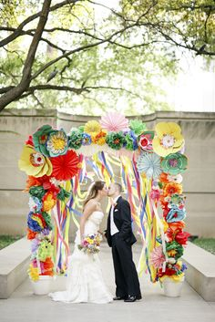 Fun and colorful ceremony backdrop.