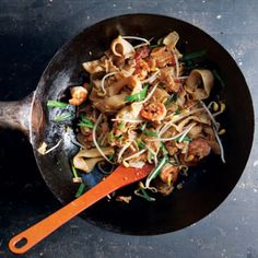 Shrimp, Chinese sausage, chiles, and chives bring intense flavor to these wok-fried noodles, a popular Malay street food.
