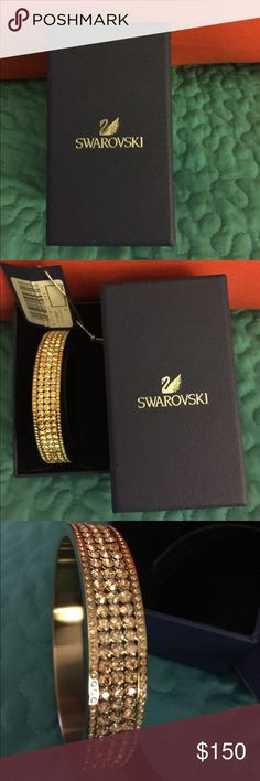 SWAROVSKI CRYSTAL GOLD BRACELET SWAROVSKI CRYSTAL GOLD BRACELET - NWT.  A stunner for sure. Swarovski Jewelry Bracelets