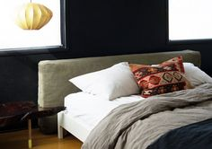 huge cushion on floor as headboard.