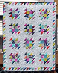 The block is a spin-off of the traditional anvil block with a border of half square triangles surrounding. I made this quilt with a variety of Cotton & Steel prints, so combining the historical roots with the modern brand of fabric used, I called it Forging Steel. by Heather Seminelli
