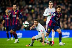 Neymar Santos Jr of FC Barcelona plays the ball next to Jorge Resurreccion 'Koke' of Club Atletico de Madrid during the Copa del Rey Quarter-Final First Leg match between FC Barcelona and Club Atletico de Madrid at Camp Nou on January 21, 2015 in Barcelona, Catalonia.