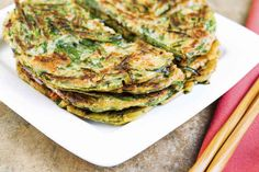 Ever wondered about the food that people have for breakfast around the world? From creamy cornbread cake in Brazil to sweet coconut jam toast in Singapore, here's how 21 destinations start the day. Korean Pancake, Breakfast Around The World, Vegetable Pancakes, Savarin, Tasty, Yummy Food, Meatless Monday, Kimchi, Organic Recipes