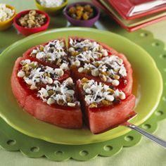 1 watermelon  (8 to 10 inch round and 1 inch thick) slice, drained to remove excess moisture  1 cup strawberry preserves  1/2 cup white chocolate chips  1/2 cup raisins  1/2 cup chopped walnuts  1 cup sweetened shredded coconut