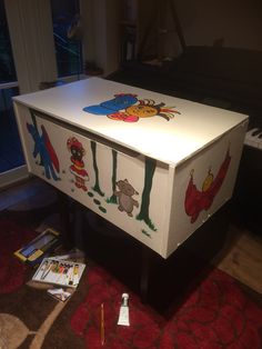 Repurposed chest of drawers and scrap wood. In the night garden toy box.