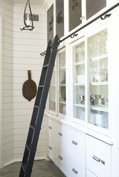 Store kitchen pantry items by frequency of use and don't be afraid to use a step stool or ladder for access.