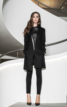 Woolen coat with leather details.