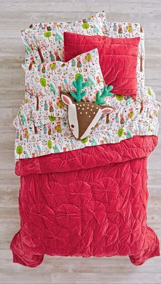 "These velvet quilts are so soft and comfy, we're pretty sure people are going to start using the idiom, ""Snug as a velvet quilt from The Land of Nod"" (at least, we hope). Pink quilt and sham features curved, gathered stitching and is available in Twin or Full-Queen"