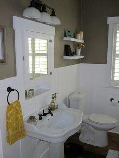 Half bathroom with white wall trim