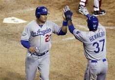 Dodger outfielder Bobby Abreu, left gets high fives after scoring the winning run in the ninth in the 6-5 win vs. the Diamondbacks on May 22, 2012.