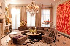 round sofa, art, and chandelier