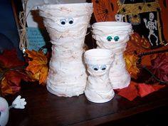 DIY Halloween Crafts - Mummies made out of terra cotta pots.