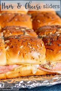 Ham and Cheese Sliders Recipe {Easy Baked Party Sandwiches} These easy ham and cheese sliders are the ultimate in party sandwiches! Savory ham and cheese on a Hawaiian bun with a baked in buttery drizzle. Party Sandwiches, Baked Sandwiches, Rolled Sandwiches, Funeral Sandwiches, Slider Sandwiches, Ham And Cheese Sliders Hawaiian, Hawaiian Roll Sandwiches, Hawaiian Rolls, Ham And Swiss Sliders