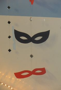 Made for masquerade party. Masks hanging from the roof on fishing wire with bits of mirror between each mask