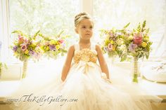 Beautiful flower girl with up do & flower dress