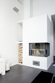 Awesome minimalist & cool #livingroom #decoration with a fireplace and storage for wood.