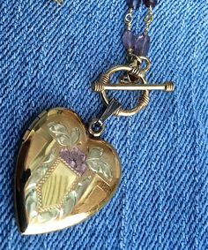 Locket, authentic vintage gold filled locket etched with designs, locket on a chain of wire wrapped gemstones assembled  by TwoSwansSwimming by TwoSwansSwimming on Etsy